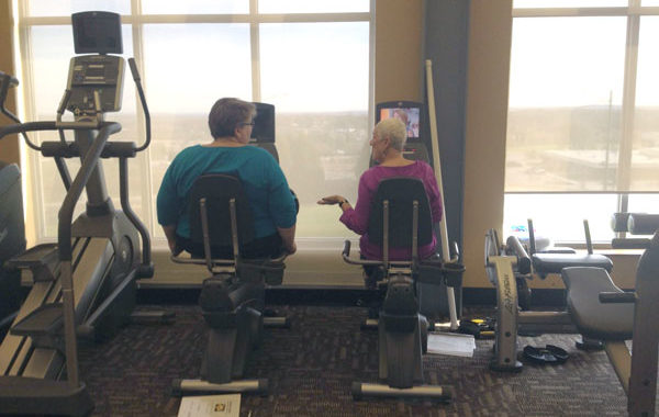 Two Ladies on workout machines